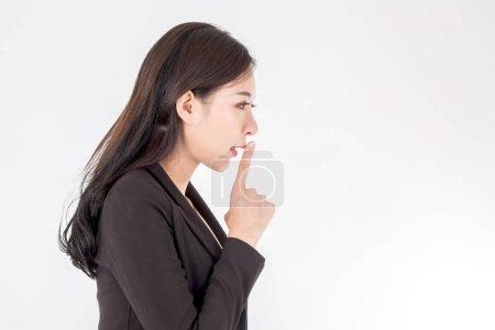 Photo pour Business woman humble geste avec le doigt sur fond blanc - image libre de droit