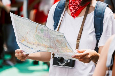Photo for Woman tourist travel holding map and camera in the street - Royalty Free Image