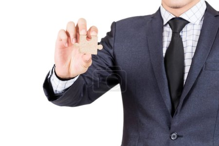 Photo for Businessman holding wood jigsaw piece isolated on white background - Royalty Free Image