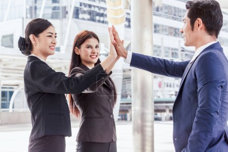 Photo for Successful  of business team giving a high fives gesture - Royalty Free Image
