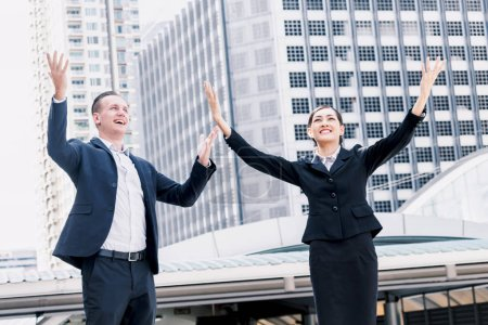 Photo for Successful business people celebrating with arms up - Royalty Free Image
