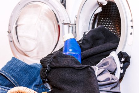 Photo for Dirty cloth in basket with washing machine - Royalty Free Image
