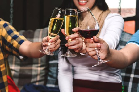 Photo for People cheers celebration with wine in restaurant - Royalty Free Image