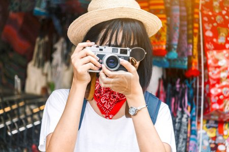 Photo for Asian woman taking picture with camera - Royalty Free Image
