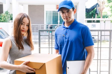 Photo for Woman accepting a delivery boxes from delivery man - Royalty Free Image