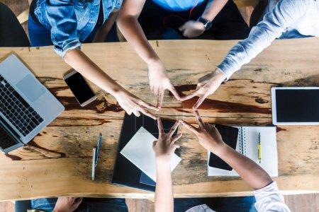 Photo for Group of people doing a star shape with fingers - Royalty Free Image