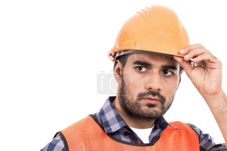 Porträt eines Bauarbeiters isoliert auf weißem Hintergrund