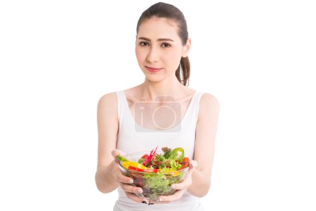 Photo for Woman holding fresh vegetable salad in glass bowl isolated on white background - Royalty Free Image