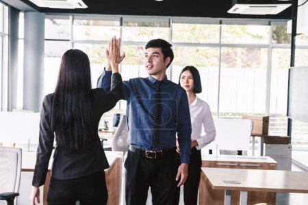 Photo for Successful business team giving a high fives gesture at office - Royalty Free Image