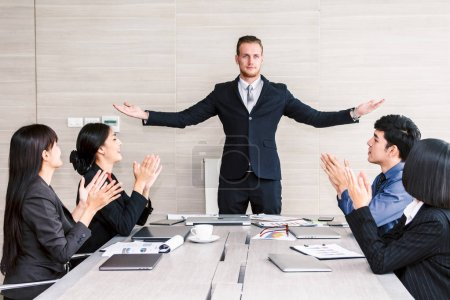 Photo for Successful business people clapping hands in the meeting - Royalty Free Image