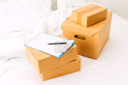 Photo for Pile of cardboard box on bed.SME business online and delivery concept - Royalty Free Image