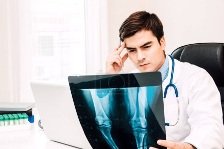 Photo for Doctor looking at x-ray photo in hospital.healthcare and medicine - Royalty Free Image