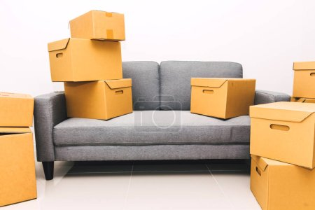 Photo for Pile of cardboard box on sofa at new home.moving home concept - Royalty Free Image