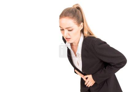 Photo pour Femme d'affaires ayant des maux de ventre douloureux isolé sur fond blanc - image libre de droit