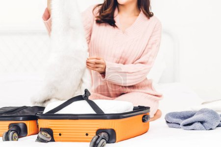 Photo for Woman packing a suitcase luggage and backpack for travel at home.Holiday vacation concept - Royalty Free Image