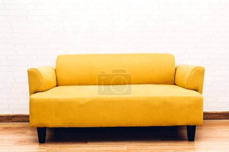 Interior sofa furniture decoration on white brick wall background