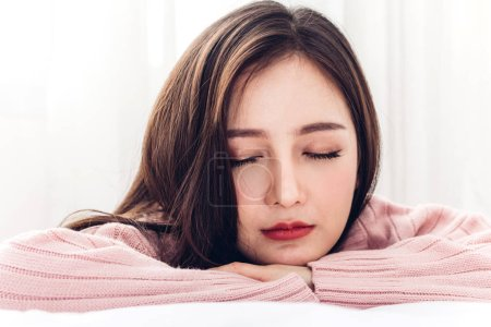 Photo for Portrait of sleeping young asia woman enjoy and relax lying on the bed with close eyes in bedroom at home.asian beauty - Royalty Free Image