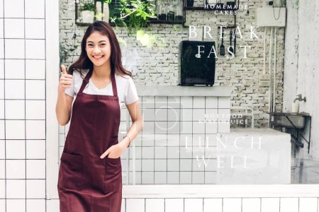 Photo for Portrait of woman small business owner smiling and standing  outside the cafe or coffee shop.woman barista standing at cafe - Royalty Free Image