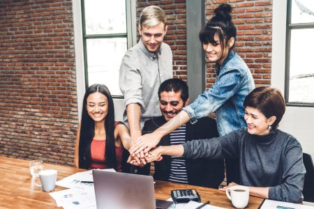 Photo for Successful of group business people stack and putting their hands together at office.Friendship teamwork concept - Royalty Free Image