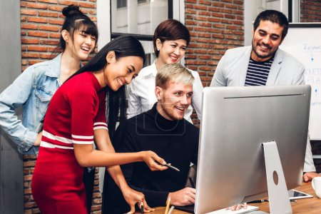 Photo for Group of casual business working and discussing strategy with desktop computer.creative business people planning and brainstorm in modern workloft.Teamwork concept - Royalty Free Image
