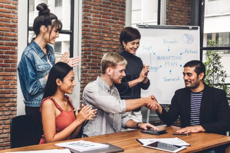 Photo for Success of handshake business partners and group of casual business clapping hands in the meeting.Partnership approval and thanks gesture concept - Royalty Free Image