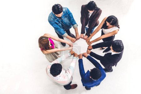 Photo for Top view of successful of group business people fist bump together  at office.success mission team meeting.Friendship teamwork concept - Royalty Free Image