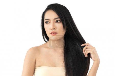 Beautiful woman beauty health care with black long shiny straigh