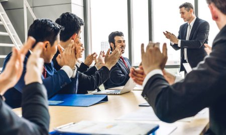 Photo for Businessman speaker presentation and discussing meeting strategy sharing ideas thoughts.Creative work group of casual business people clapping hands in modern office.Success concept - Royalty Free Image