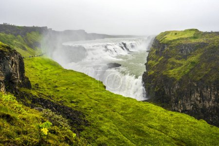 Photo for Gullfoss waterfall in the fog. Canyon of Hvita river in southwestern Iceland. - Royalty Free Image
