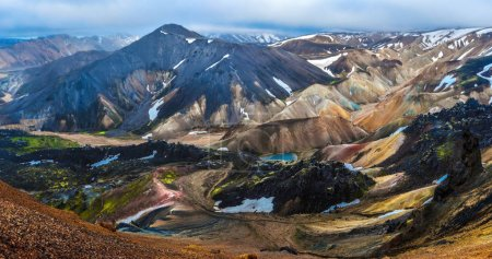 Photo for Mountain landscape panorama of Landmannalaugar in midnight light seen from Brennisteinsalda volcano mountain in Highlands of Iceland. Fridland ad Fjallabaki Natural park in July. - Royalty Free Image
