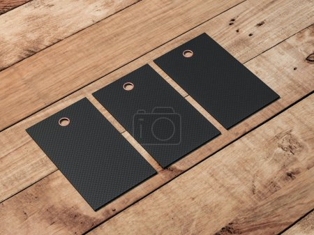 Photo for Three black tags mockups on wooden table, show your price and brand - Royalty Free Image