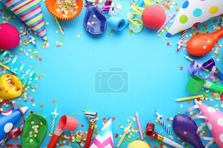 Photo for Birthday party caps, blowers and candles on blue background - Royalty Free Image
