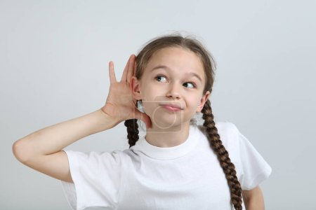 Cute young girl on grey background