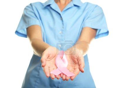 Doctor holding pink ribbon, medicine concept