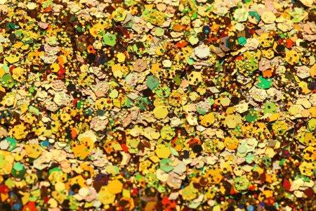 Golden confetti background, closeup