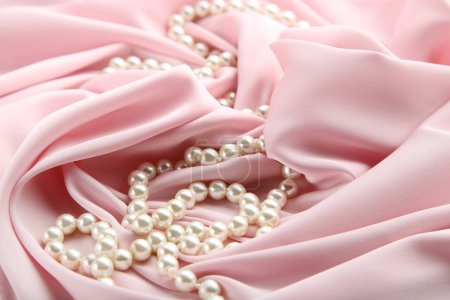 Photo for Pearl necklace on pink satin fabric - Royalty Free Image
