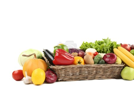 Ripe fruits and vegetables in basket on white background