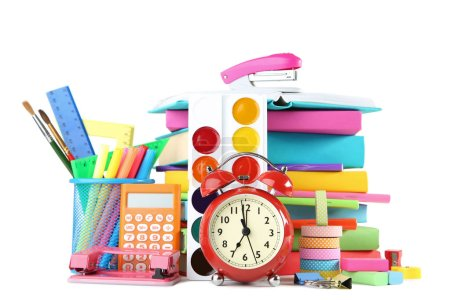 Photo for School supplies with alarm clock on white background - Royalty Free Image