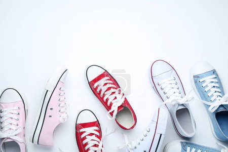 Different colorful sneakers on white background