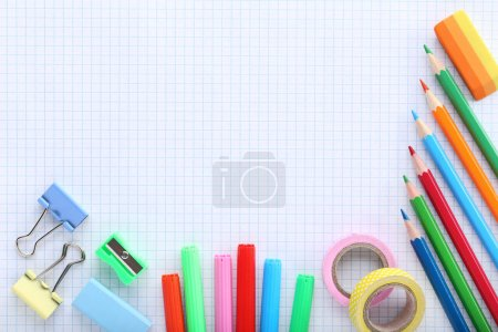 School supplies on checkered exercise book background