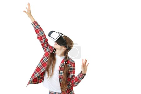 Young girl in virtual reality goggles isolated on white background