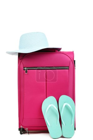Photo for Pink suitcase with hat and flip flops isolated on white background - Royalty Free Image