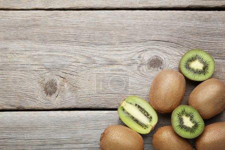 Kiwi fruits on grey wooden table