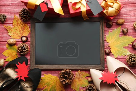 Wooden frame with sale tags, dry leaves and high-h...