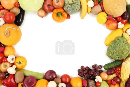 Ripe fruits and vegetables on white background