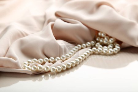 Pearl necklace with beige satin fabric