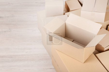 Photo for Stacked empty cardboard boxes on floor - Royalty Free Image