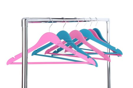 Photo for Colorful wooden hangers hanging on white background - Royalty Free Image