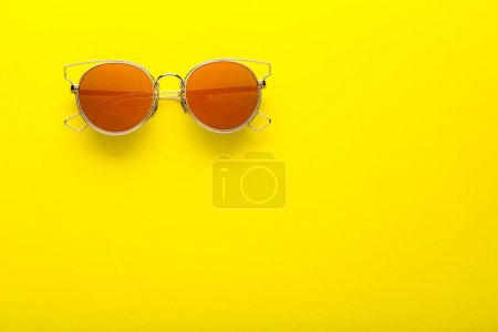 Photo for Modern sunglasses on yellow background - Royalty Free Image