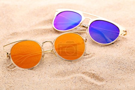 Photo for Colorful sunglasses on the beach sand - Royalty Free Image